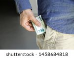 hand with hundred euros and... | Shutterstock . vector #1458684818