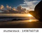 Setting Sun Above Huge Rock At...