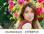 beautiful woman in garden with... | Shutterstock . vector #14588914