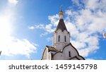 Orthodox white church on blue...