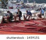 Fishermen Mending Nets In...