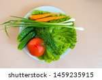 vegetables on a white dish ...