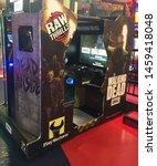 "Small photo of Wisconsin, USA; July 2, 2019: A ""Walking Dead"" video game based on the TV series of the same name, at the Tom Foolery arcade section of the Kalahari Resort in the Wisconsin Dells."