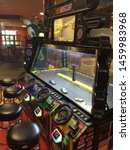 "Small photo of Wisconsin, USA; July 2, 2019: A game allows players to remotely control ""NASCAR"" replica toy cars in a race track at the Tom Foolery arcade section of the Kalahari Resort in the Wisconsin Dells."