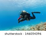Male Scuba Diver Swimming...