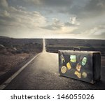 Vintage Suitcase On A Deserted...