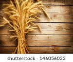 Wheat Ears On The Wooden Table...