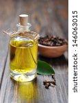 oil of cloves in a glass bottle ... | Shutterstock . vector #146063015