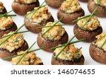 baked mushroom caps stuffed... | Shutterstock . vector #146074655