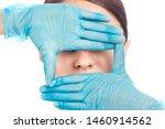 doctor's hand in gloves around...   Shutterstock . vector #1460914562