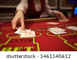 Small photo of The croupier in the casino does a shuffle of cards