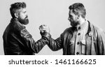 Strong handshake. Friendship of brutal guys. Leadership concept. True friendship of mature friends. Male friendship. Brutal bearded men wear leather jackets shaking hands. Real men and brotherhood.