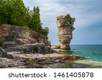 Small photo of On Flowerpot island in Fathom Five National Marine Park, one of the two rock pillars or sea stacks, rise from the waters of Georgian Bay.