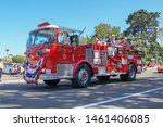 Old Firetruck And People At Th...