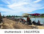 laborer working near river | Shutterstock . vector #146145926