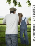 rear view of a father with... | Shutterstock . vector #146165576
