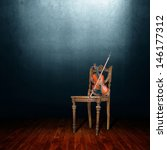 Old Chair And Violin In An...