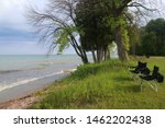 Beautiful summer landscape in a state park. Lake Michigan scenic view with chairs on the beach at the Harrington Beach State Park, Wisconsin, USA. Wisconsin nature background.