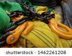 Yellow Grade 80 Grab Shortener and Latch Lock Hooks attached to Chain Sling, resting upon 2 and 3 tonne synthetic round slings.