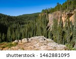 Red rock sandstone canyon wall and rock outcropping above the Piedra River near Pagosa Springs, Colorado - stock photo