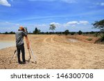 land surveyors using camera on... | Shutterstock . vector #146300708