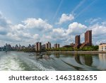 Upper Manhattan East side of New York City by the Harlem River. East Harlem is known as Spanish Harlem and dominated by public housing complexes with a high concentration of older tenement buildings.