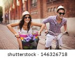 couple riding bicycles in the... | Shutterstock . vector #146326718