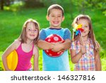 three smiling kids in a summer... | Shutterstock . vector #146327816