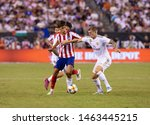 Small photo of East Rutherford, NJ - July 26, 2019: Toni Kroos (8) of Real Madrid & Joao Felix (7) of Atletico Madrid fight for ball during game as part of ICC tournament at Metlife stadium Atletico won 7 - 3