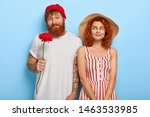 Stock photo millennial couple have first date red haired woman wears straw hat and striped summer dress feels 1463533985