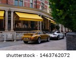 Small photo of London, England - 27 July 2019: Two rare Porsche sports cars parking in front of The Connaught hotel, in Mayfair. The exact models: a yellow Porsche 911 Carrera 2.7 RS, and a white 911(991) GT2RS.