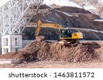 Small photo of The excavators (hydraulic) excavation on the pile of soil. Excavators are also called diggers, JCBs, mechanical shovels, or 360 degree excavators. Tracked excavators are sometimes called trackhoes.