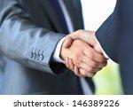 handshake in office | Shutterstock . vector #146389226