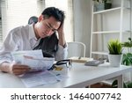 stressed young asian... | Shutterstock . vector #1464007742