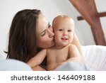 portrait of a loving mother... | Shutterstock . vector #146409188