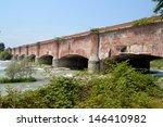 Old brick bridge on the Dora Baltea river, Piedmont, Italy.