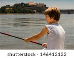 young boy fishing on the river...   Shutterstock . vector #146412122