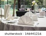 Table set for meal in modern restaurant - stock photo