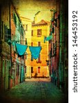 Stock photo vintage style picture of an old alley with laundry lines in venice italy 146453192