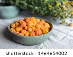 A Bowl Of Cloudberry And Dried...