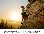 Beautiful Woman Climbing On The ...