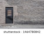 Old Grey Brick Wall With Black...
