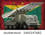 tactical short range ballistic missile with arctic camouflage on the Grenada flag background. 3d Illustration