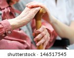 senior woman with her caregiver ... | Shutterstock . vector #146517545