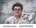 young crazy scientist performs... | Shutterstock . vector #1465282382