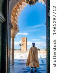Small photo of Guard soldier in national costume at the entrance of Mausoleum of Mohammed V and square with Hassan tower in Rabat on sunny day. Location: Rabat, Morocco, Africa