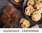 Small photo of Baked Creamy Dark chocolate chip cookies , Cookie crumble cracks and Brownie chocolate chip cookie on the black dish plated on dark texture background Image using for commercial or menu layout design
