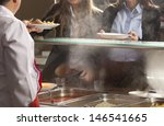 Stock photo chef standing behind full lunch service station 146541665