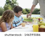 two children at outdoor table... | Shutterstock . vector #146595086