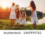 Family Walking By Summer River...